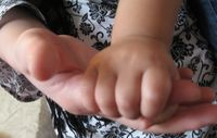 Awe_little girl and women hand